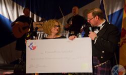 Iain Leyden presents a cheque to Jolanta Czernicka-Siwecka of Fundacja Iskierka